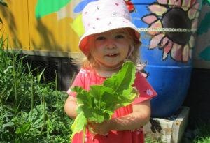 ESFP's Little Sprouts program - girl in garden with lettuce